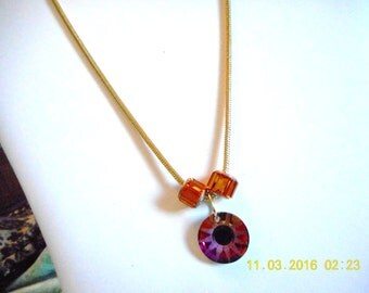 Snake Chain Necklace ... gold plated snake chain, Swarovsky faceted step bead, Swarovsky sun burst pendant ... #701