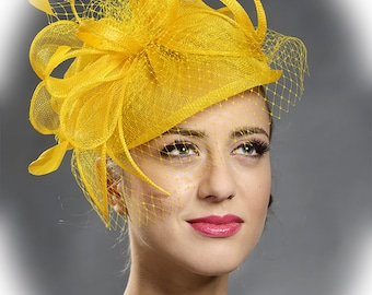 Yellow trendy fascinator hat for the weddings, races, parties