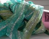 sari ribbon yarn . beach glass 17 . 1 skein 66yds 50g . louisa harding sari ribbon . turquoise green silver . wide sparkle ribbon art yarn