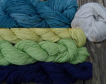 960 yards of pure wool yarn in sport weight, 5 colors, 10.5 oz.