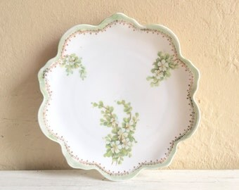 Pretty Porceiain Dish with Scalloped Edge Green Leaves Gold Trim and White Flowers