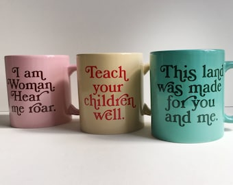 Old School Coffee Mugs - I am Woman Hear me roar, Teach your children well, and This land was made for you and me