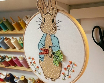 Bluebell Rabbit freehand machine embroidery framed on a hoop with a ribbon hanging bow. 3D ears and carrots. New baby gift