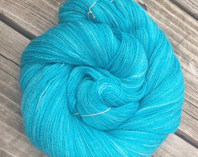 hand dyed lace weight yarn cashmere blend yarn Kiss from a Mermaid 875 yards baby alpaca silk cashmere light turquoise teal blue green