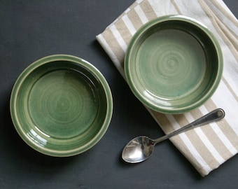 Two minimalist style tapas snack bowls - glazed in forest green