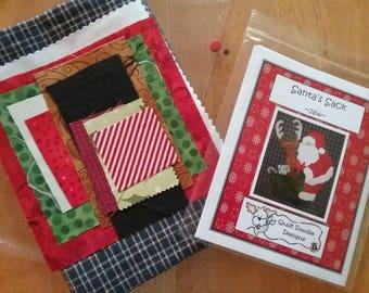 Santa's Sack, Santa and his reindeer applique Tea Towel Kit  pattern with a navy blue tea towel