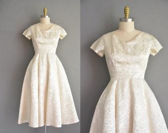 50s soft ivory silk satin bridal wedding dress with a leaf foliage print. vintage 1950s dress