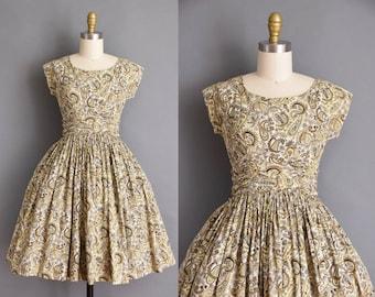 vintage 1950s dress. Adorable 50s brown and yellow paisley print cotton vintage dress