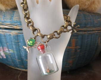 Vintage Brass Charm Bracelet with Boat in Bottle Charm Fish Charm and Jacks Charm