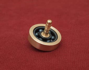Roller bearing spinning top, lathe turned EDC desk toy