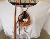 Drawstring leather bag with bone carved buffalo