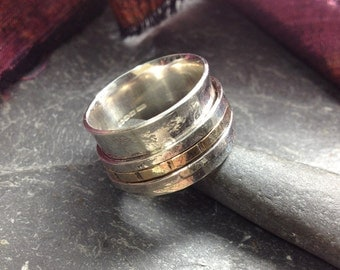 Wide silver and gold spinner ring