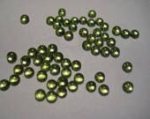 Natural Peridot cabochons ...      approx 4 mm ...... 2 pieces  ....        B4295