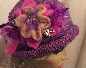 Downton Abbey Style Crocheted Hat...A Large felted Flower on a Lavender Hat with a Purple Band and Feathers