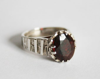 Vintage garnet and sterling silver ring. UK size I.  US size 4.5.  Very small ring