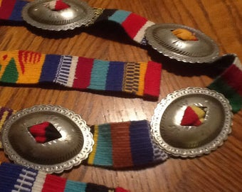 Textile and Silver Conchos Belt