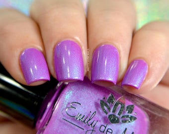 "Nail polish - ""Ava"" a bright purple with strong turquoise blue shimmer"