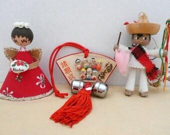 THREE International Christmas Ornaments - Hawaii, Mexican Bull Fighter, Japanese Kokeshi Dolls