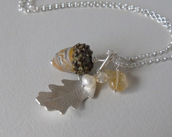 Silver oak leaf and mustard glass acorn necklace