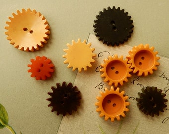 9 Vintage Assorted Size Bakelite Gear Buttons Lot 1