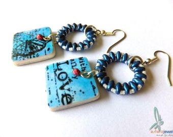 With love - handmade, lightweight earrings in blue and white with handmade polymer charms and beaded rings