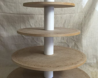 5 tier round unfinished cake pop stand with X base.  Holds up to 134 cake pops.