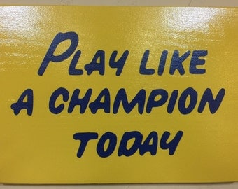 "Officially Licensed Play Like a Champion Today Sign Replica 12""x17"" - Standard finish"
