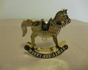 Vintage 1980s to 1990s Gold Tone Merry Christmas Rocking Horse Christmas Ornament Lightweight Not Perfect Shiny