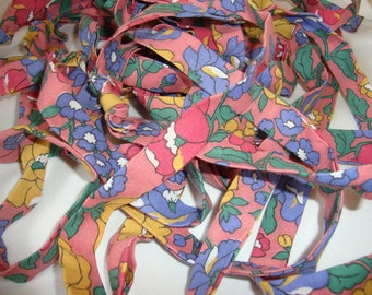 Pink Flowered Cotton Fabric Ribbon, 2 1/2 inch fabric folded to 3/4 inches wide, 7 1/2 yards of Knotted Fabric, Rag Rugs