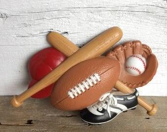 Burwood sports wall decor. Football, bat, baseball, hat, wall hanging.