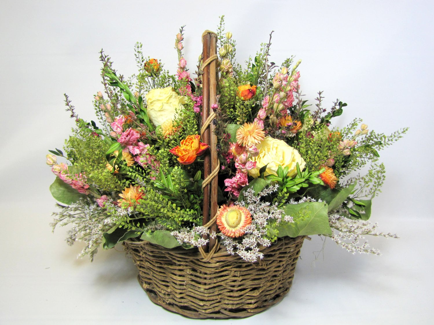large dried floral arrangement centerpiece rustic basket