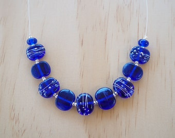 Recycled Glass Bead Necklace. Glass Beads made from a Skyy Vodka Bottle