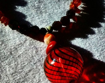 Red Venetian glass pendant on gemstone and pearl necklace.