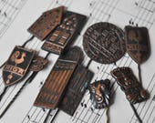"Set of 10. Vintage Latvian copper badges,pins.""Riga""."