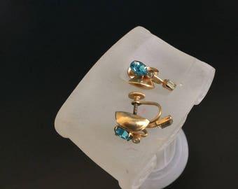 Rhinestone earrings modernist unusual sapphire blue rhinestones with baguette MCM screw on earrings jewelry bargain 1950s 1960s