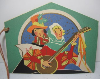 Colorful gold gilded die cut Art Deco 1920's-30's christmas bridge tally card renaissance era caroler and musician in colorful attire,snow
