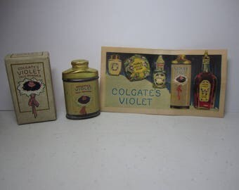 Art deco 1910's-20's unused tin of Colgate's Violet talc powder in original box with illustrated paper insert graphics of a posy of violets