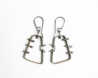 contemporary earrings, bronze earrings, brass earrings, unique earrings, contemporary jewelry, peruvian design, original jewelry design