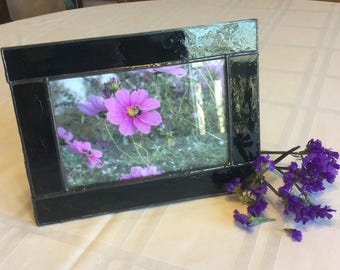 Black stained glass photo frame holds a 4 x 6 photo