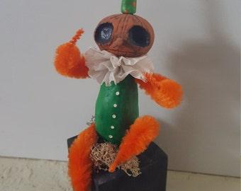 Green sitting pumpkin
