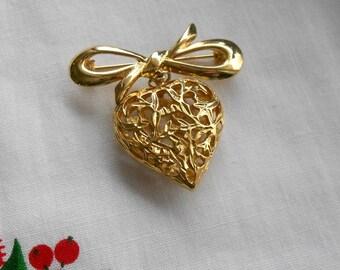 Vintage gold heart brooch.  Open metal work.  Bow top.