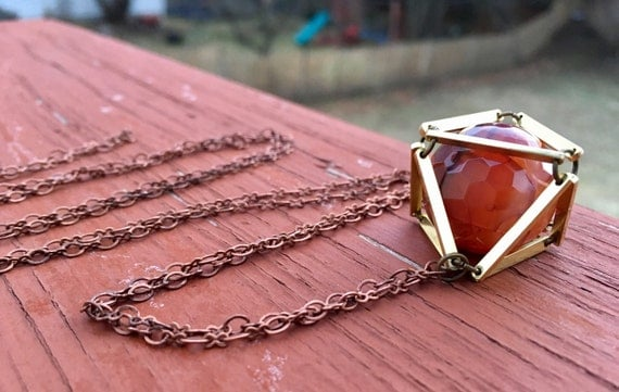 Orange Dragon Veins Caged In Brass Necklace