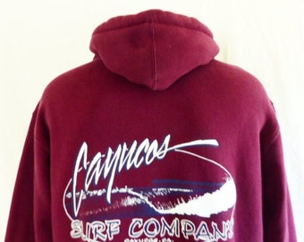 vintage 90s Cayucos Surf Company hoodie graphic sweatshirt maroon red fleece back front white navy blue surf wave logo print oversize medium