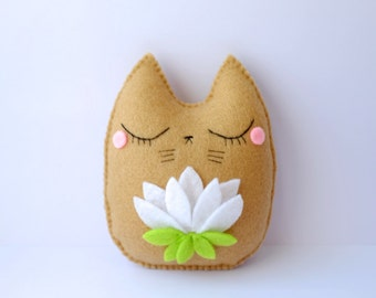 Cute cat doll with a Lotus flower
