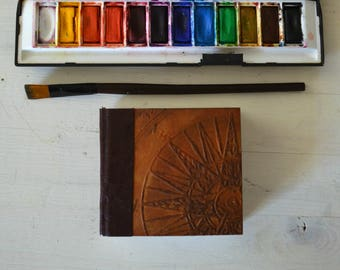 Handmade pocket watercolor journal, with  300gsm Fabriano Acquerello paper and embossed covers