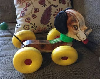 Vintage Fisher Price Wobbles the Dog pull toy