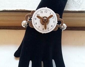 Bracelet steampunk oiseaux avec cadran de montre