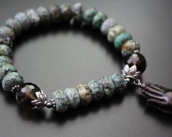 African turquoise gemstone bracelet carved ebony wood praying hands charm bracelet tribal urban safari bracelet stretch spiritual bracelet