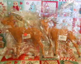 Two New/Old Store Stock Flocked Reindeer
