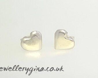 Cute solid silver heart stud earrings. pretty little love hearts handmade from solid sterling silver